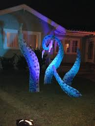 halloween pirate party painted sea monster tentacles next to a pirate ship wreck