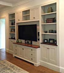 this custom entertainment center was recessed into the wall