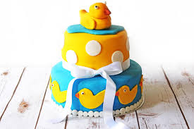 two tier celebration cake for baby shower supper in the suburbs