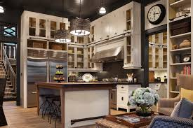 impressive kitchen features extra tall ceilings and a butler
