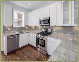 white kitchen cabinets with gray granite countertops kitchen