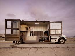 shipping container gets converted into a wood fired pizza oven