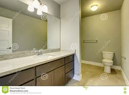 light bathroom interior with tile floor and vanity cabinet with