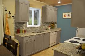 small kitchen design with exposed stone backsplash and gray