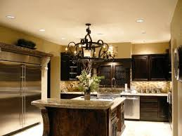 black steel chandelier dark brown wooden kitchen island counter