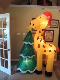 christmas inflatables image gemmy giraffe with christmas tree jpg gemmy