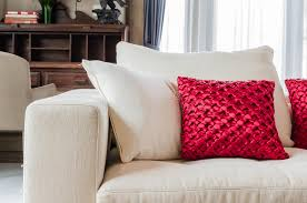 beautiful pillows for sofas red and white pillow on white sofa at home stock image image of