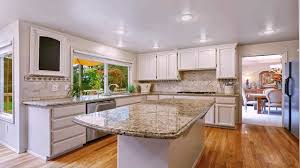 white kitchen cabinets with gold countertops white kitchen cabinets with venetian gold granite
