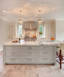 stained island kitchen transitional with pendant lights glass