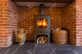 roaring fire inside wood burning stove in brick fireplace with