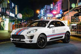martini design porsche macans embellishes singapore streetscapes