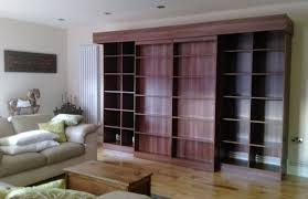 sliding bookcase murphy bed wallbed behind sliding bookcases diy wardrobes information centre