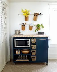 kitchen island with trash bin this rolling kitchen island features a beautiful butcher block