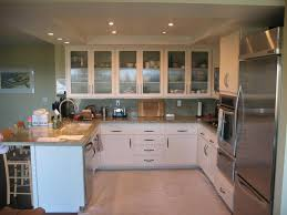 exquisite white wooden kitchen cabinets with glass door featuring