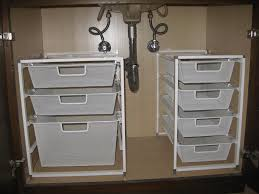 narrow bathroom with dark brown bathroom cabinet and two white