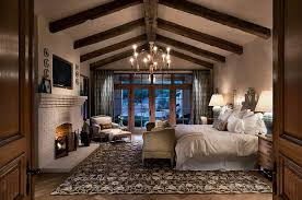 Traditional Master Bedroom - traditional master bedroom with metal fireplace by bill bisset