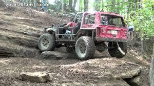 badass jeep cherokee jeep cherokee climbs axle hill at trucks gone wild youtube