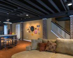 this exposed basement ceiling was spray painted black due to the
