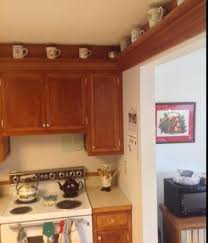kitchen on top of cabinets decorating above kitchen cabinets ideas tips