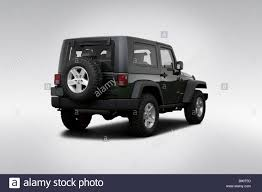 Wrangler 2009 2009 Jeep Wrangler Rubicon In Green Rear Angle View Stock Photo