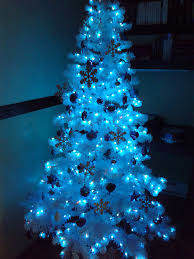 my loved a white tree with all blue lights and