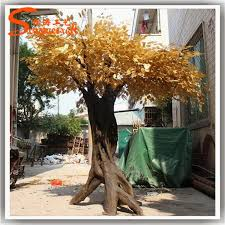 large gold leaf and tree roots made of artificial gold tree for
