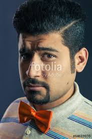 middle eastern hair cuts for men portrait of hispanic middle eastern serious man with orange bow