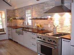 how to choose a wood countertop for your kitchen mahogany wood countertop provides a warm contrast to stainless steel and white shaker kitchen cabinets