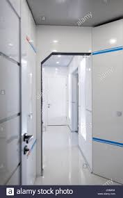 modern home hallway interior white plactic panels and tiles stock