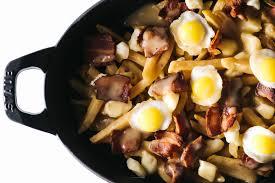 poutine cuisine the breakfast poutine fries crispy quail eggs cheese