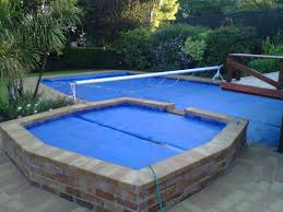 swimming pool solar covers which uses solar reels can make it easy