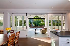 love these gorgeous giant sliding doors for the back of the house