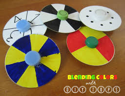 very cool cd spinning tops that combine craft art and science