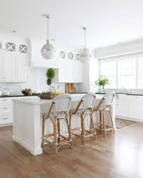deciding where to save or splurge barstool edition studio mcgee classic white kitchen with bistro stools studio mcgee
