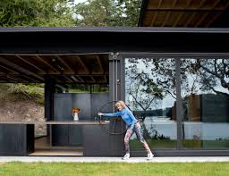 olson kundig creates a mechanized cabin that literally invites the