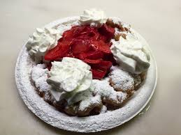 funnel cake with whipped cream and strawberry topping oc