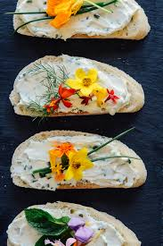 edible flower garnish cheese and chive sandwiches with edible flowers buttered