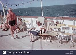 Chairs On A Beach Elderly Woman Relaxing On A Beach Chair On Deck Of An East German