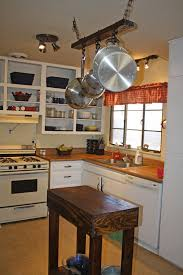 kitchen pot rack with light designing a kitchen with a hanging