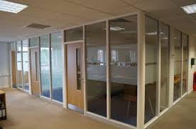 l shaped glass wall partitions with light brown wooden doors and