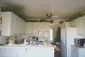 top of kitchen cabinet greenery greenery above kitchen cabinets our house now a home