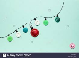 creative concept photo of christmas lights made of buttons on