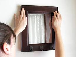 how to hang a picture frame how to hang a frame without leaving a mark apartment therapy
