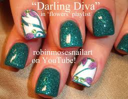teal glitter nails with lavender abstract filigree flowers nail