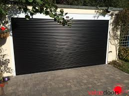 wood composite garage doors garage doors spanish style ceramic tile roof on two car garage