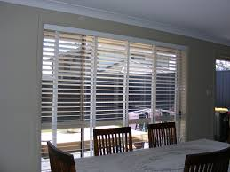 Beige Walls White Trim by Blinds U0026 Curtains A Blue Wall With Glass Window And White Trim