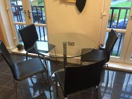 barker and stonehouse glass circular table with free black leather