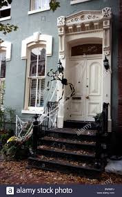 halloween decoration at house entrance with spiders stock photo