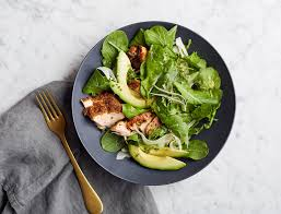 arugula salad with fennel crusted salmon and avocado goop
