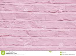 brick wall painted a pretty pink color background stock photo